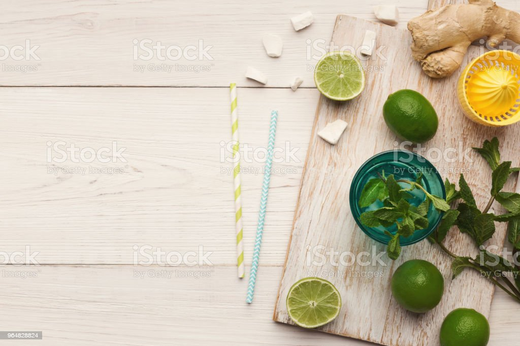 Making lemonade at home, ingredients on white wooden table royalty-free stock photo