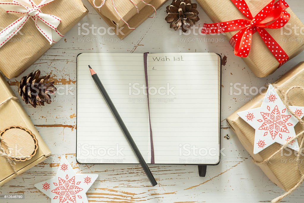 Making list of presents on wood background stock photo