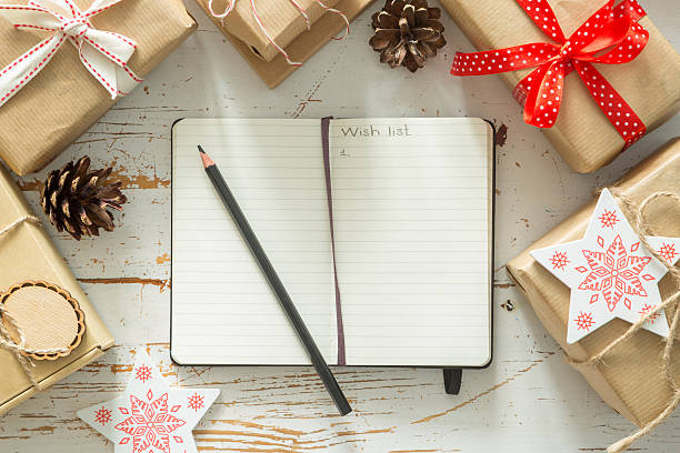 making list of presents on wood background - list stock photos and pictures