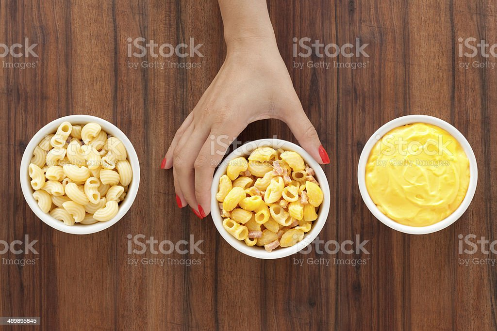 Making macaroni and cheese royalty-free stock photo