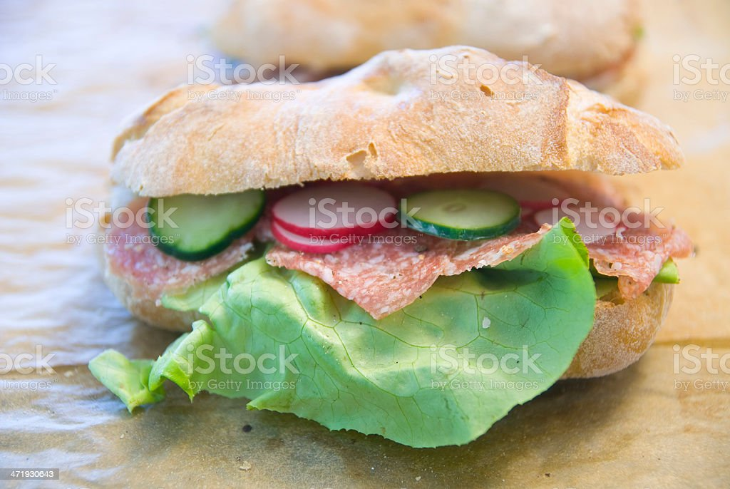 making many sandwiches with salami for buffet party royalty-free stock photo