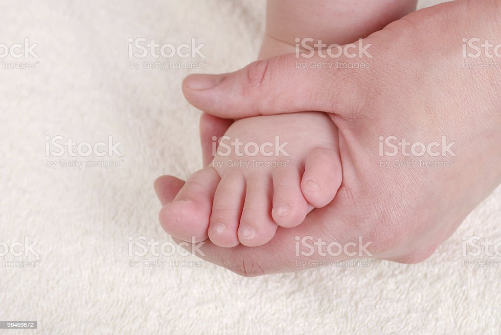 Making massage of children's foot royalty-free stock photo