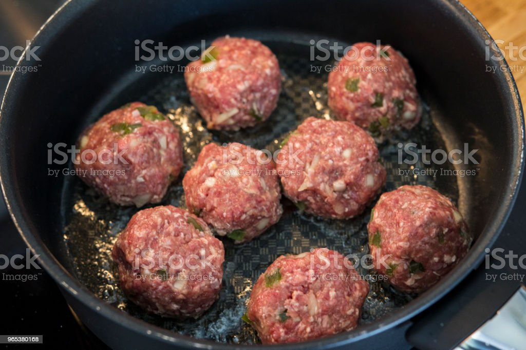 Making meatballs in a kitchen royalty-free stock photo