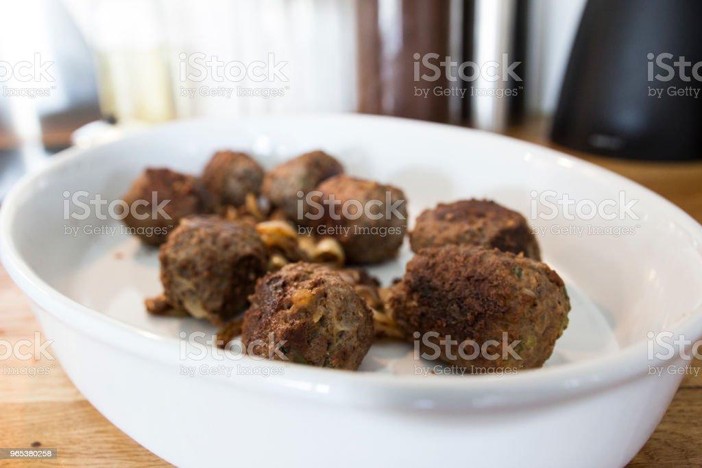 Making meatballs in a kitchen zbiór zdjęć royalty-free