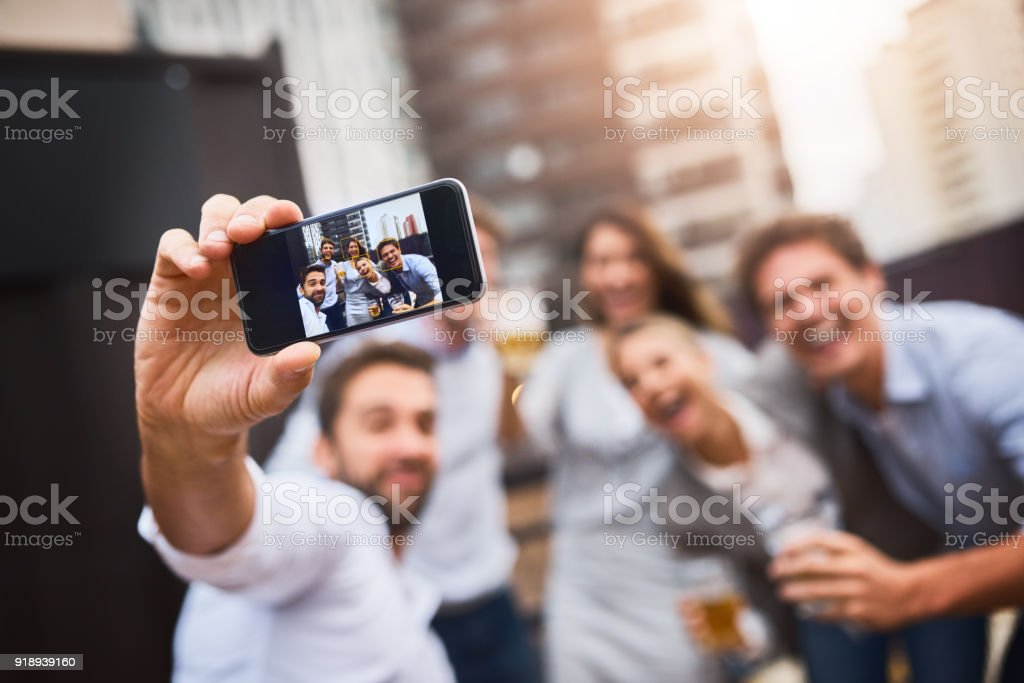 Making memories after work with colleagues - foto stock