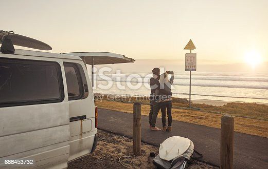 Shot of a young couple taking a selfie while on a roadtrip together