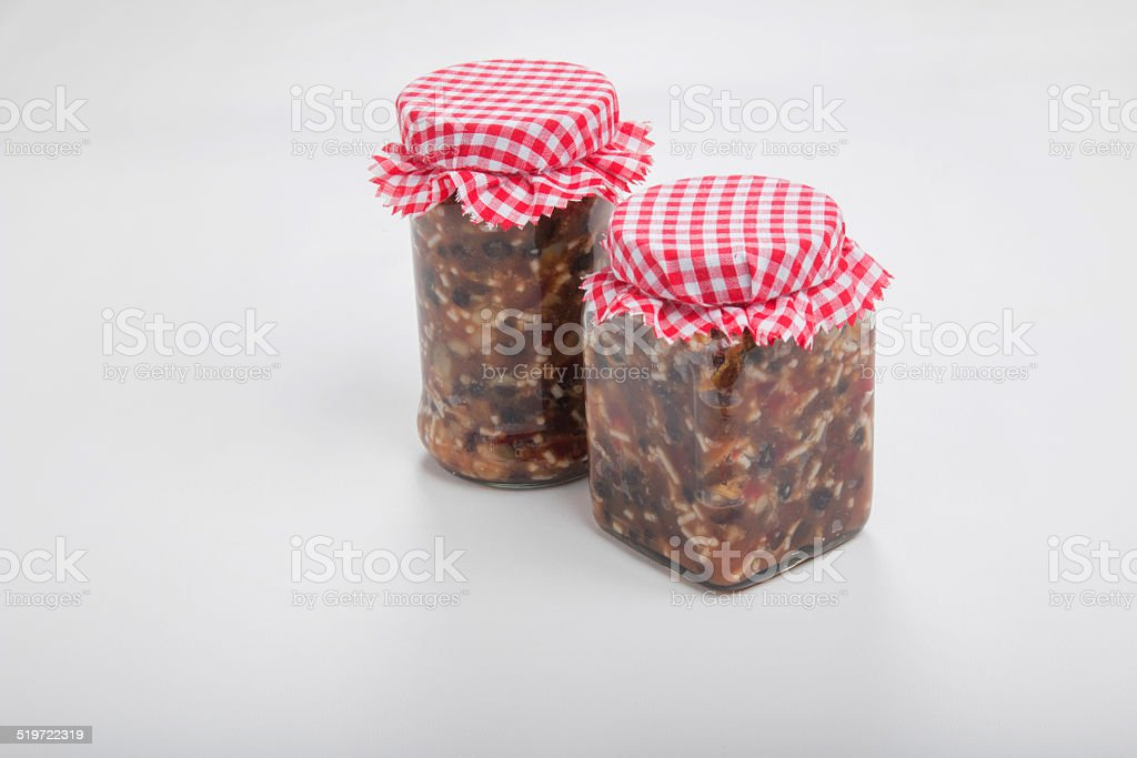 making mincemeat, 2 jars mincemeat with red and white check stock photo