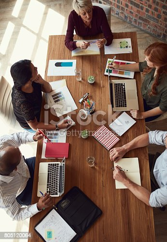 High angle shot of a group of colleagues having a meeting in a modern office