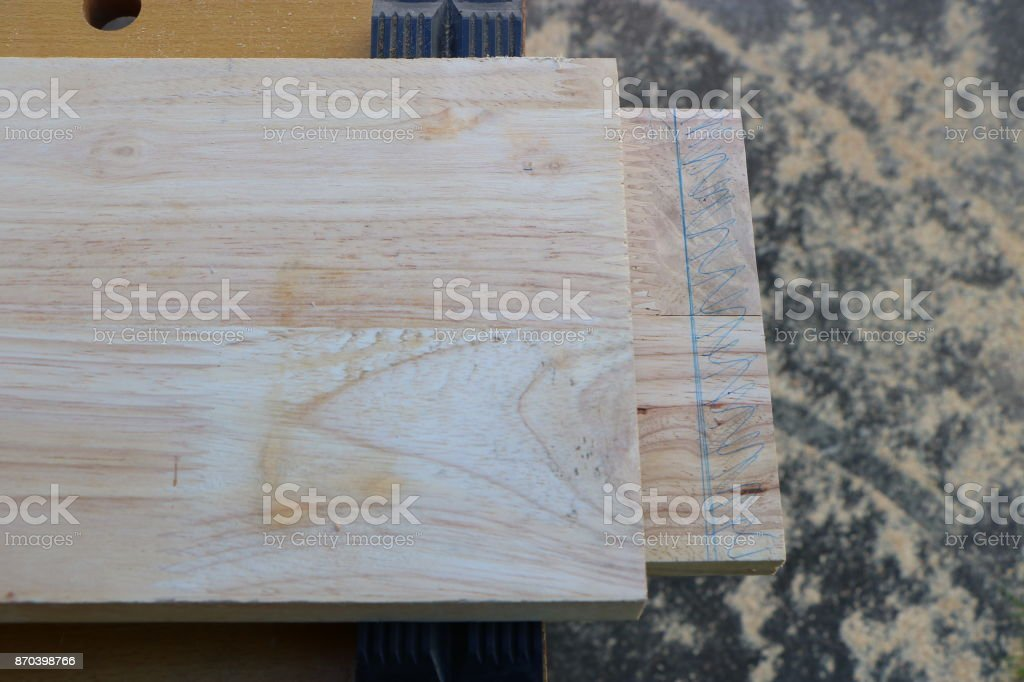 Making mortise and tenon joint with chisel stock photo