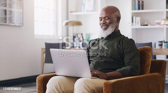 Shot of a mature businessman using a laptop in an office