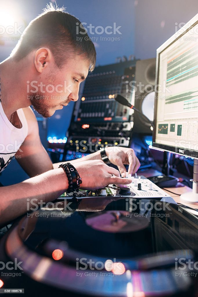 DJ making music in the recording studio stock photo