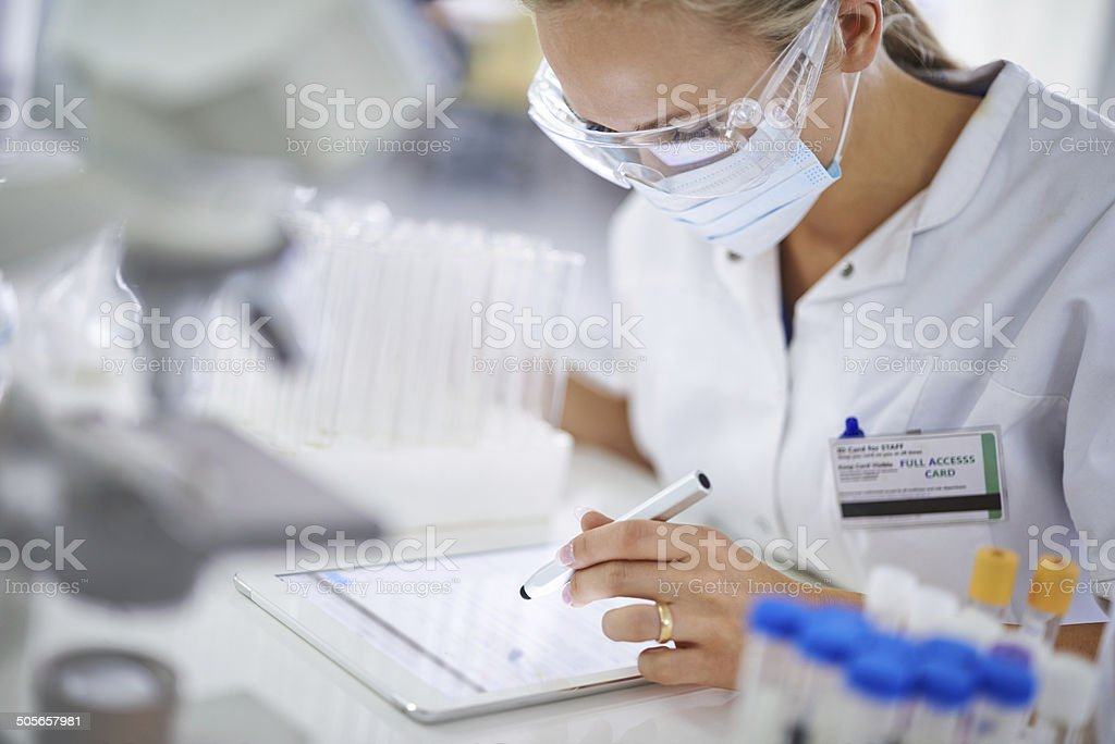 Making notes for her thesis stock photo