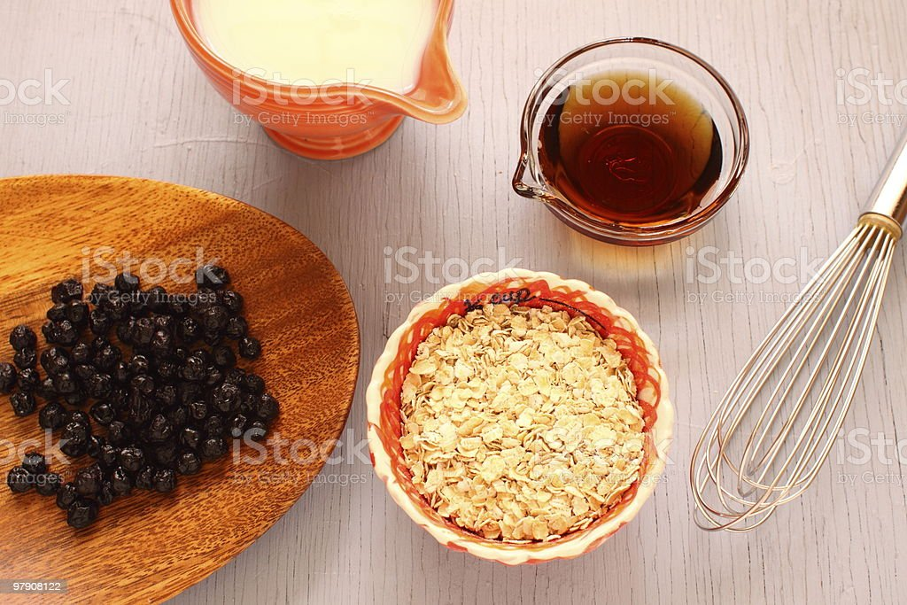 Making Oatmeal with Dried Blueberries royalty-free stock photo