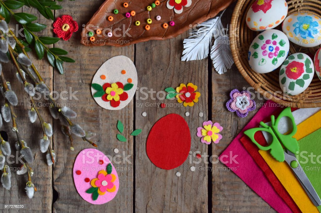Making of handmade easter eggs from felt with your own hands. Children's DIY concept. Making Easter decoration or greeting card. Step 1. Cut out the egg. stock photo