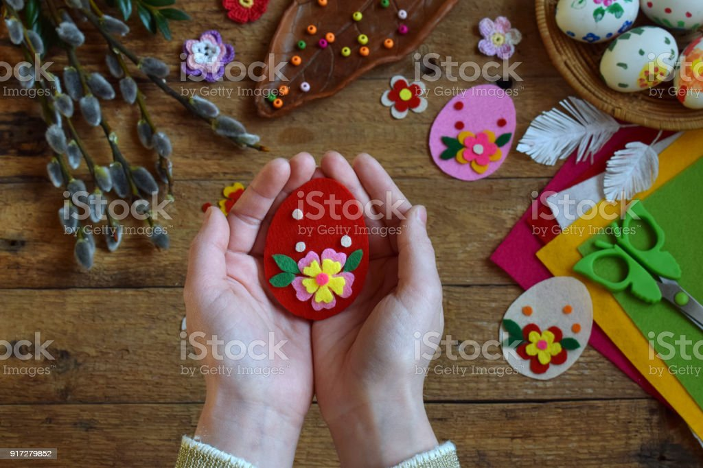Making of handmade easter eggs from felt with your own hands. Children's DIY concept. Making Easter decoration or greeting card. Step 3. The finished toy egg. stock photo