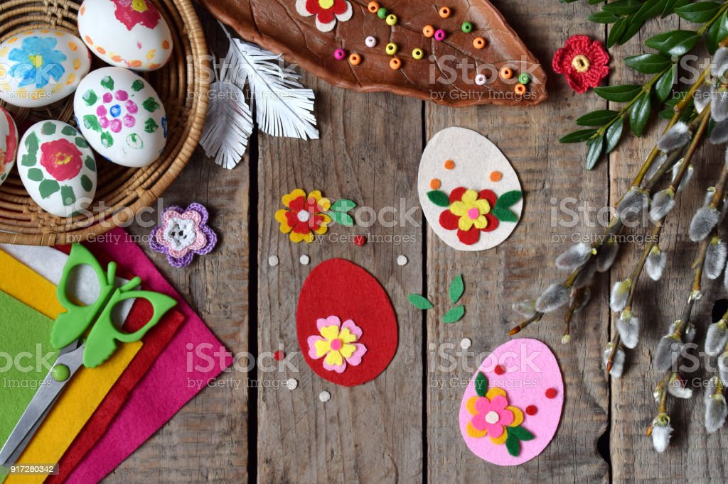 Making of handmade easter eggs from felt with your own hands. Children's DIY concept. Making Easter decoration or greeting card. Step 2. Decorate the egg. stock photo
