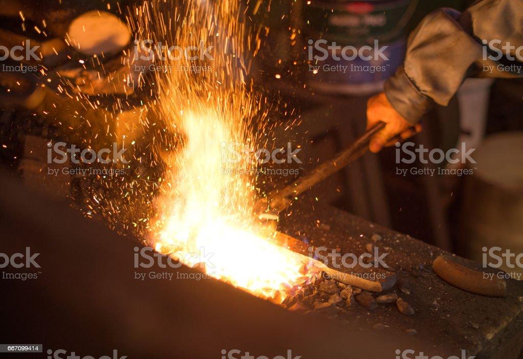 Making of horseshoe. Hot horseshoe in forge. stock photo