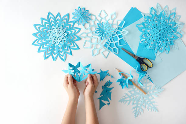 making of snowflakes from blue paper. - art and craft stock pictures, royalty-free photos & images