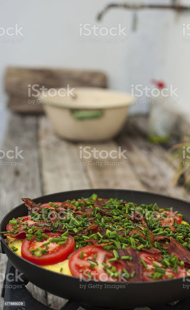 Making omelet outdoors royalty-free stock photo