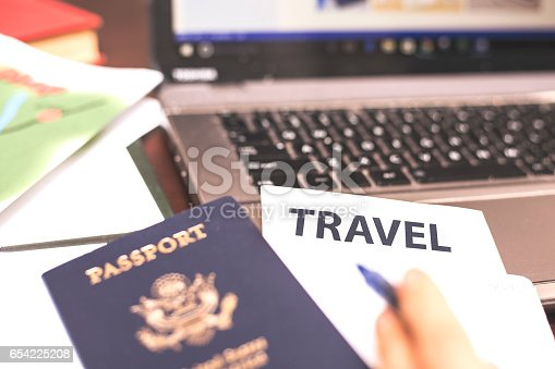 istock Making online travel reservations using laptop computer 654225208