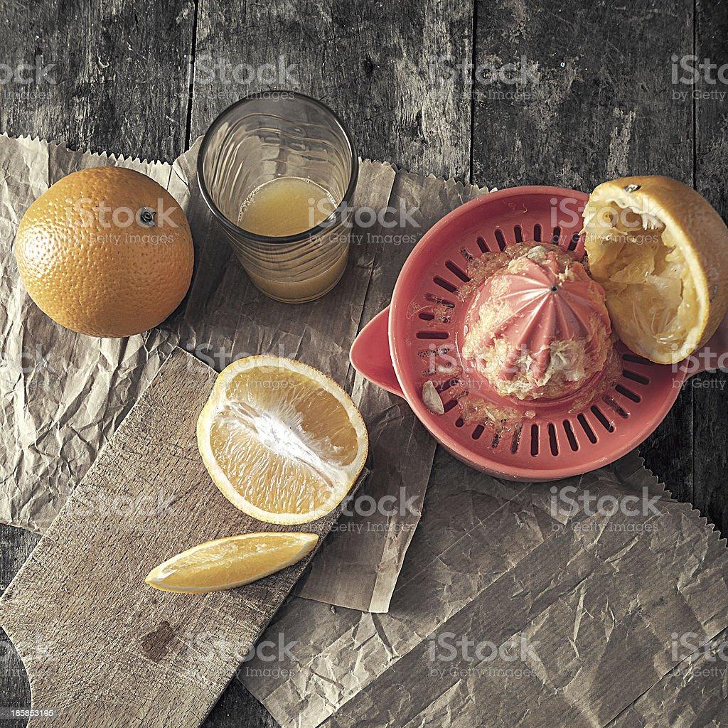 making orange juice stock photo