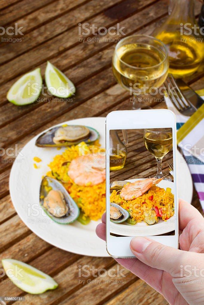 making photo of paella stock photo