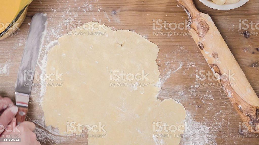 Making pie crust from scratch to bake pumpkin pie stock photo