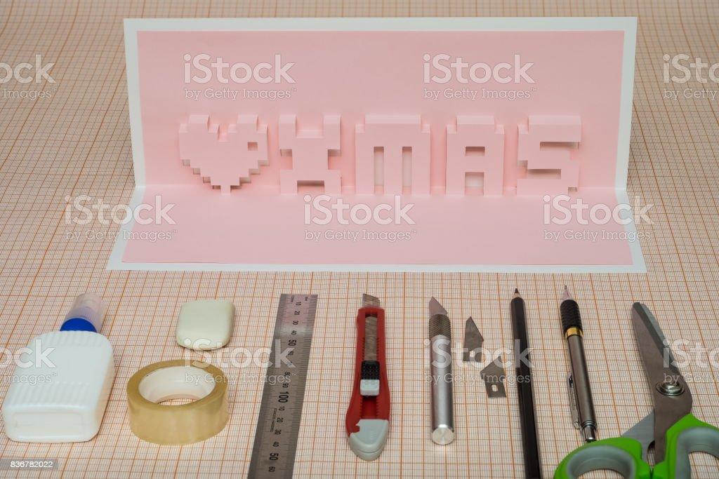 Making  pop-card  with inscription xmas. stock photo