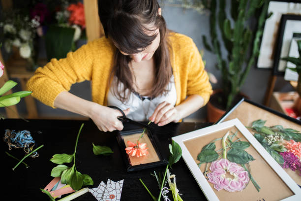 Making pressed flowers frames stock photo