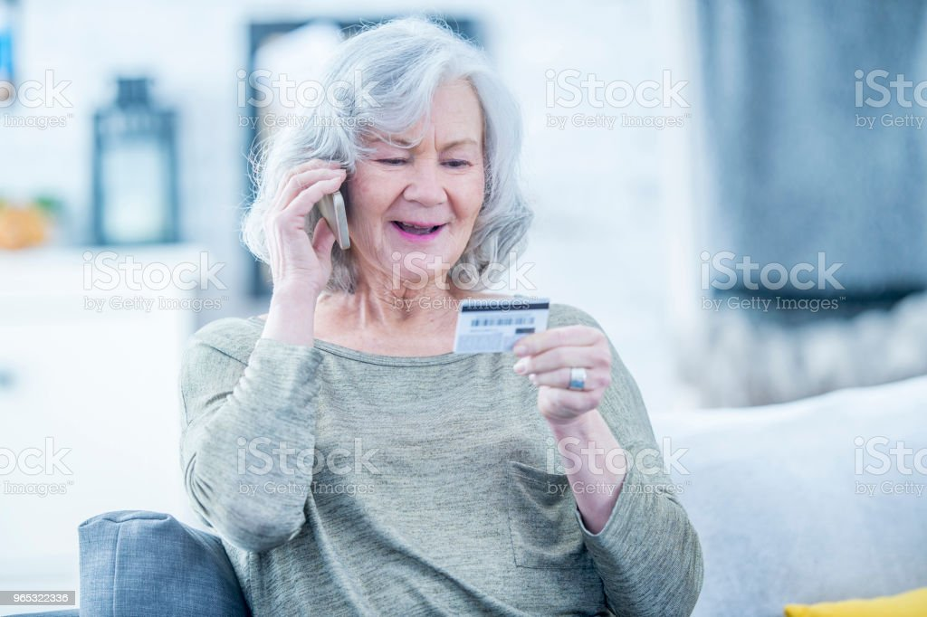 Making Purchase Over The Phone royalty-free stock photo