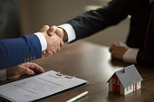 Making real estate deal, handshake with agent