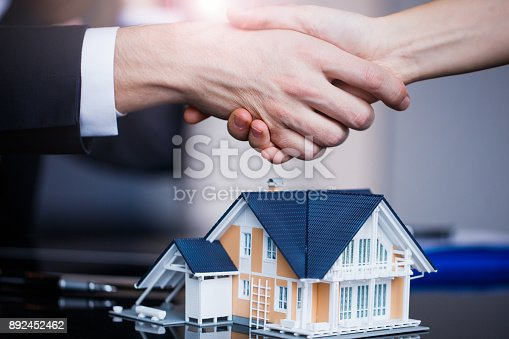 istock Making real estate deal, handshake with agent 892452462