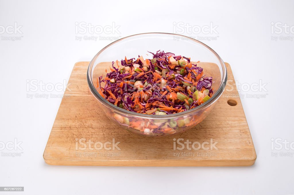 Making red cabbage slaw, finished coleslaw stock photo
