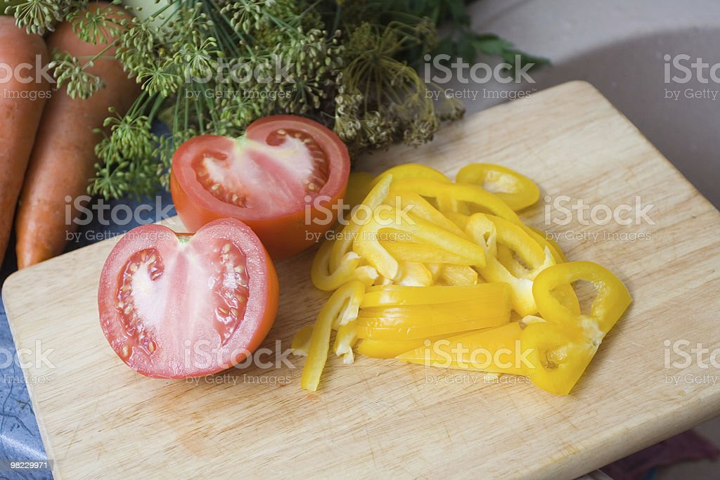 Making salad with potato and cucumber royalty-free stock photo