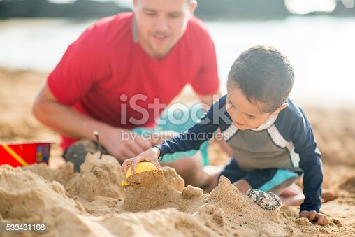 605742160 istock photo Making Sand Castles on the Beach 533431108