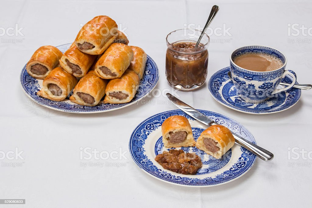 Making sausage rolls finished rolls some on willow pattern plate stock photo