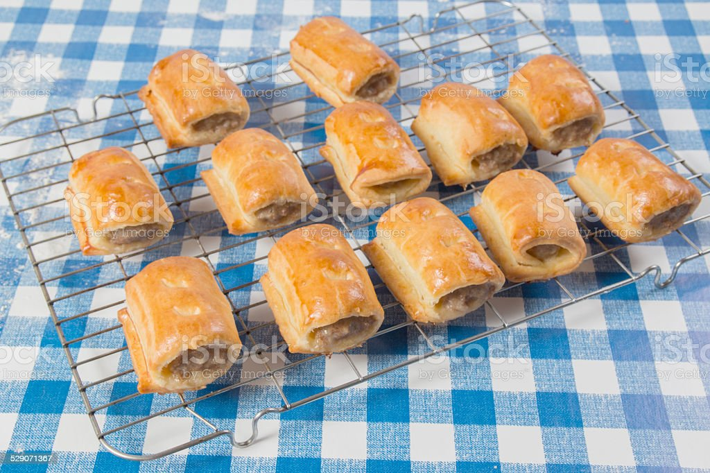 Making sausage rolls, finished sausage rolls, baked, on cooling rack stock photo