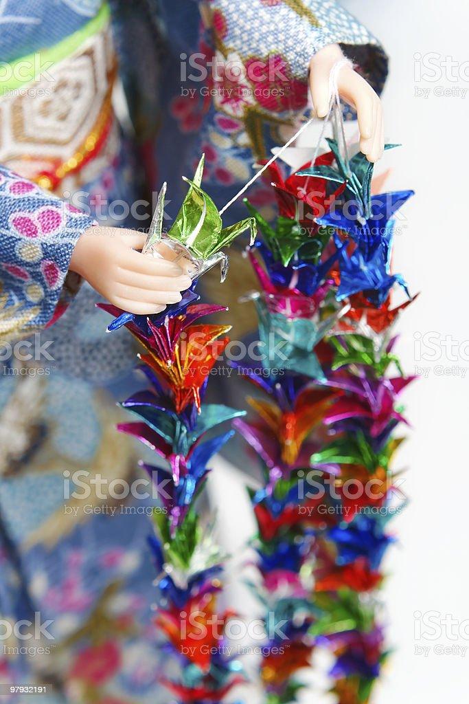 Making Senbazuru (a thousand origami cranes) royalty-free stock photo