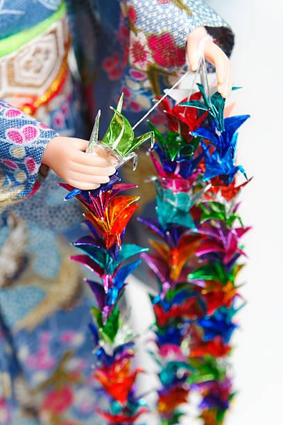 Making Senbazuru (a thousand origami cranes) stock photo