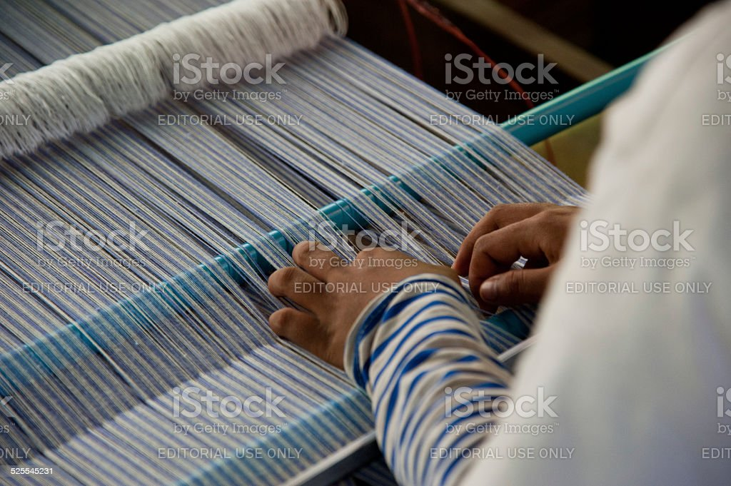 Making silk cloth in factory stock photo