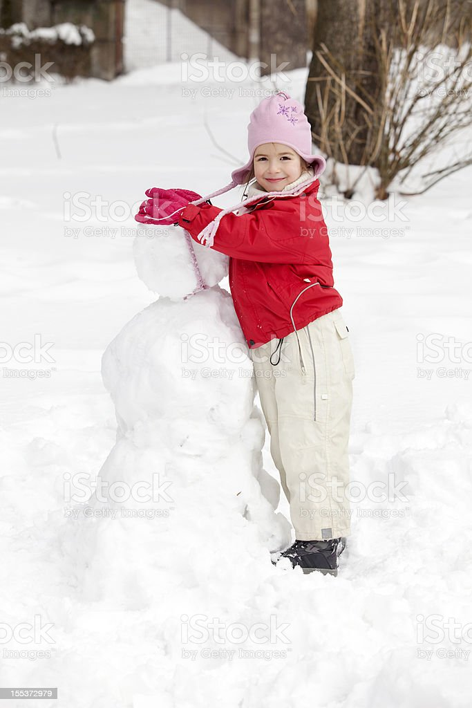 Making snowman royalty-free stock photo