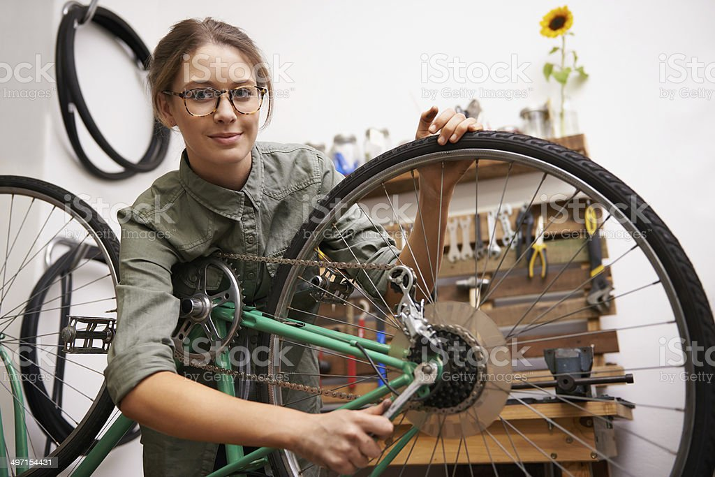 Making some adjustments to her bike stock photo