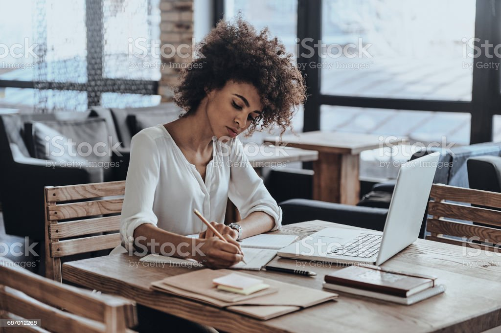 Making some notes. stock photo