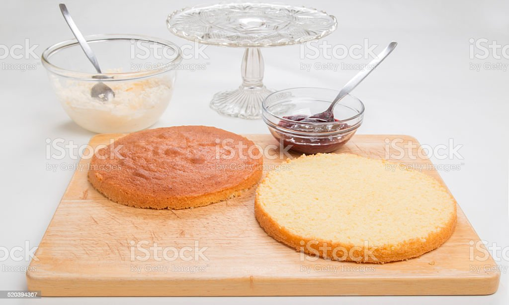 Making sponge cake,   ready to add jam and butter cream stock photo