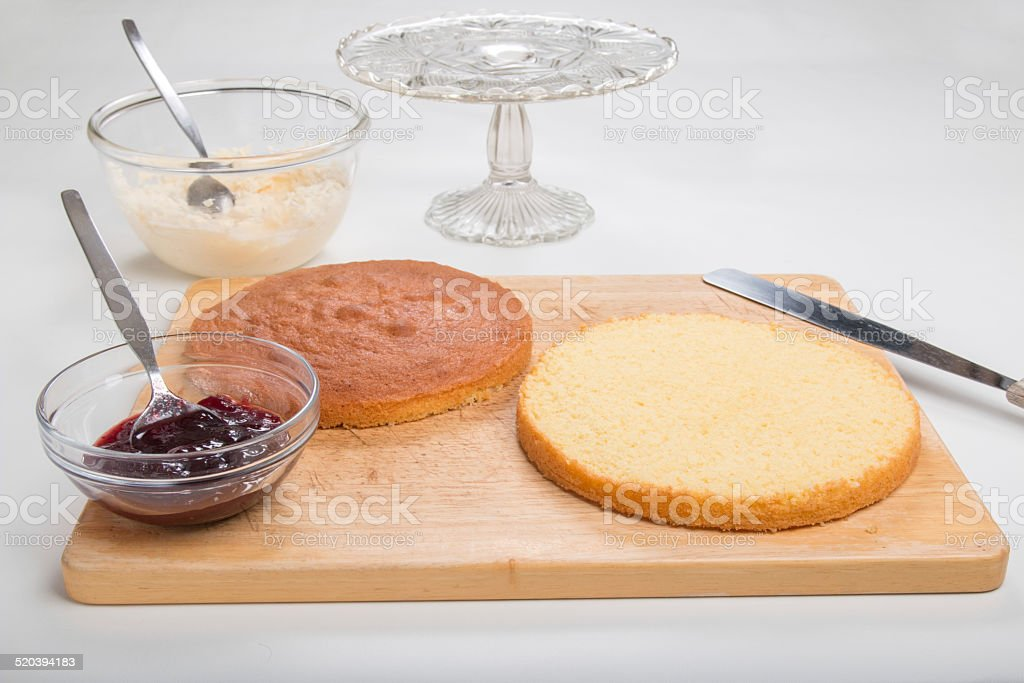 Making sponge cake, sliced ready to add jam and buttercream stock photo