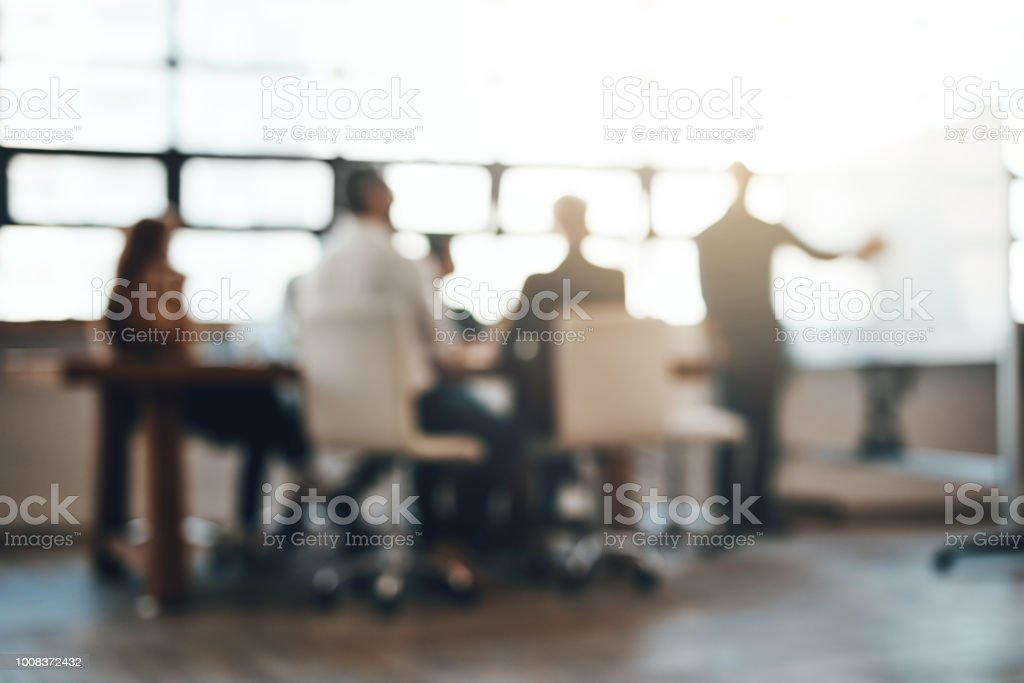 Making success happen Shot of businesspeople having a meeting in an office Adult Stock Photo