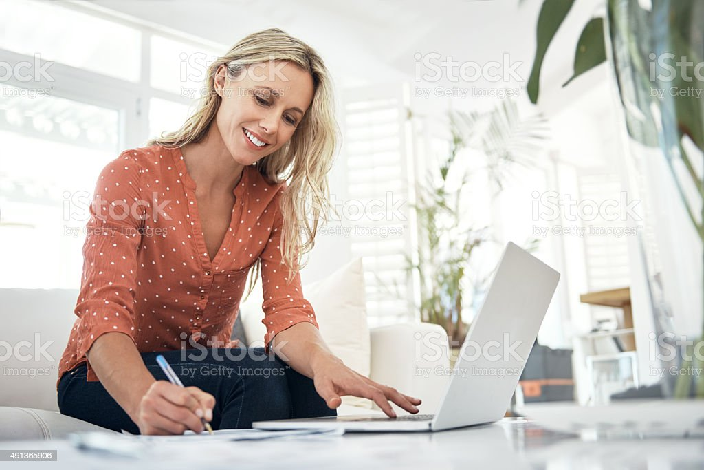 Making sure all her bills are paid stock photo