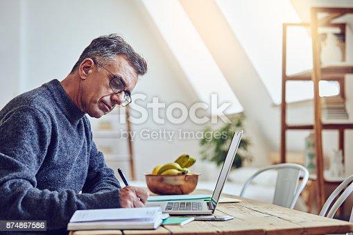 Shot of a senior man using a laptop at home