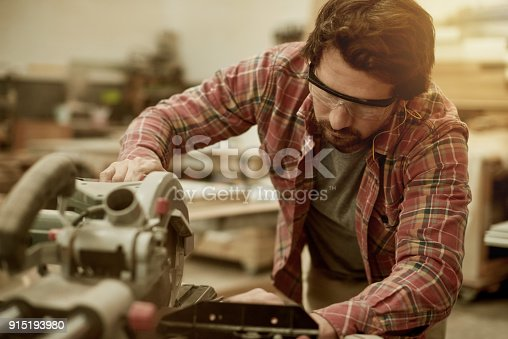 915192732istockphoto Making sure he cuts it perfectly 915193980