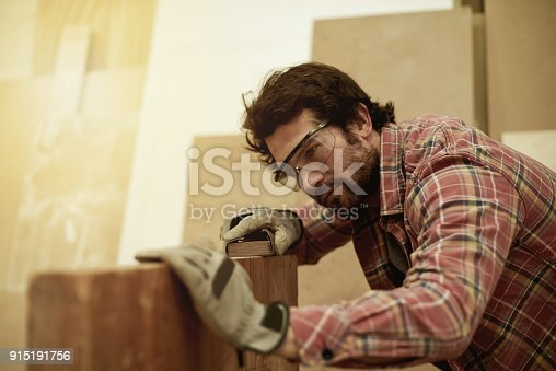 915192732 istock photo Making sure he delivers perfect work 915191756